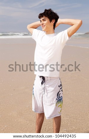 Young handsome man relaxing at the beach - stock photo
