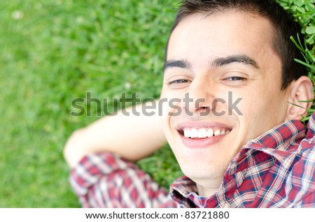 Young handsome man relaxing outdoor smiling