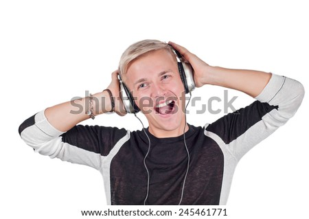 Young handsome man singing with headphones  - stock photo