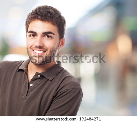 young handsome man smiling over an abstract place