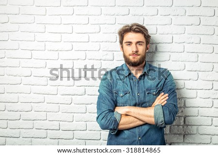Young handsome man standing - stock photo