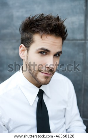 Young handsome man staring at camera - stock photo