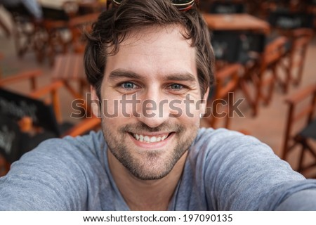 Young Handsome Man Taking Selfie - stock photo