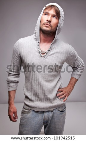 young handsome man thinking - stock photo