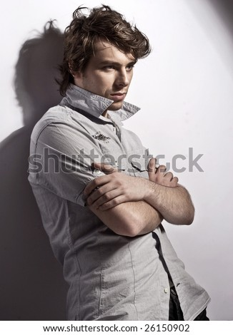 young, handsome man thinking - stock photo