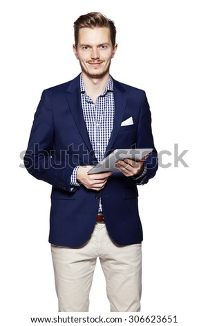 Young handsome man using digital tablet. Standing against isolated white background - stock photo