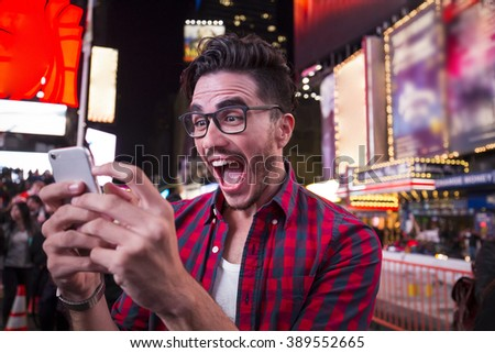 Young handsome man wearing a fashionable outfit in the city - stock photo