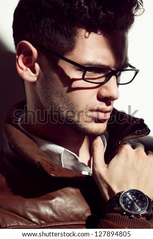 Young handsome man wearing fashion eyeglasses