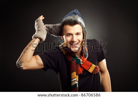 young handsome man wearing nice winter fur hat - stock photo