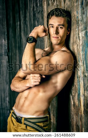 Young handsome man with beautiful muscular body. Men's beauty, healthcare. - stock photo
