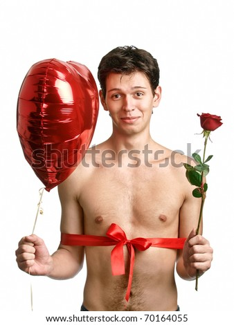 young handsome man with big heart and red rose like a present - stock photo