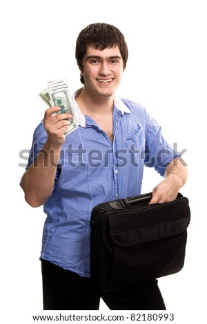 Young handsome man with case holding dollars