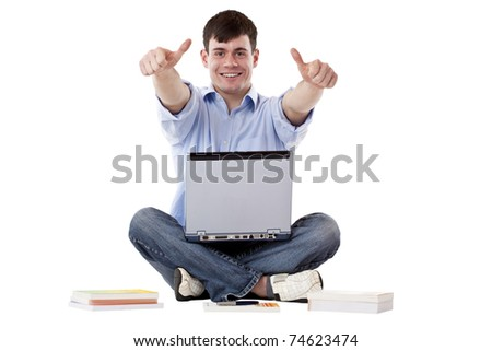 Young, handsome man with computer express success with thumbs up. Isolated on white background. - stock photo