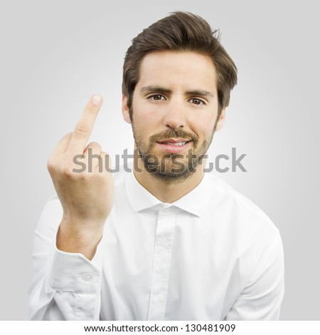 young handsome man with disagreement gesture isolated over gray background