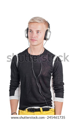 Young handsome man with earphones - stock photo