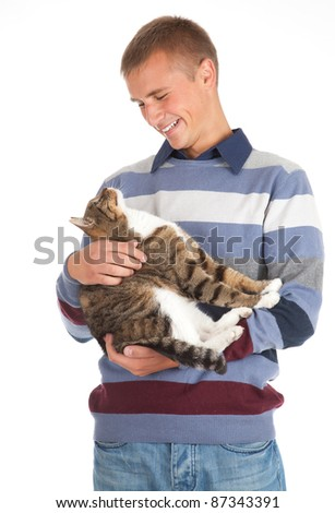 young handsome man with grey cat, white background
