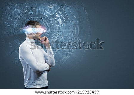 Young handsome man with hologram around head - stock photo
