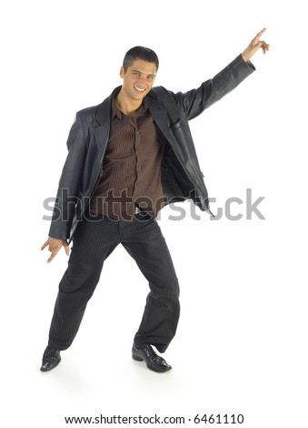 Young, handsome man with raised hand. Standing in dancing pose. Smiling and looking at camera. Isolated on white in studio. Whole body, front view