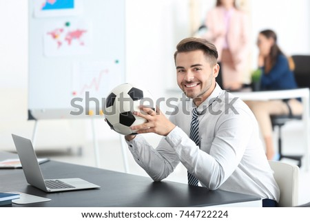 young handsome man soccer ball office stock photo royalty free 744722224 shutterstock