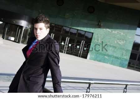 Young handsome model posing for corporative portrait.
