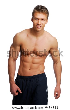 Young handsome muscular man with beautiful body. Isolated on white. - stock photo