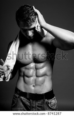 Young handsome muscular man with beautiful muscular body. Isolated on white. - stock photo