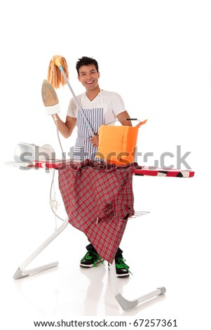 Young handsome Nepalese man happy ironing and cleaning. Studio shot, white background. - stock photo