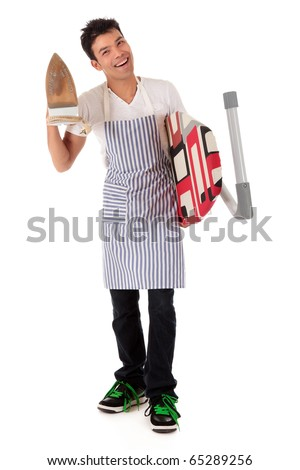 Young handsome Nepalese man holding an ironing-board and an iron. Preparing ironing. Studio shot, white background. - stock photo