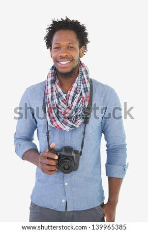 Young handsome photographer on white background - stock photo