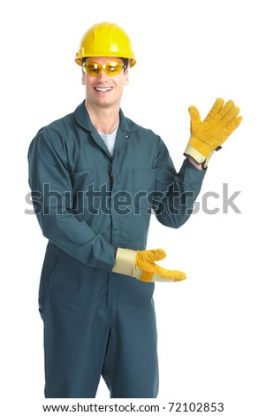 Young handsome plumber worker with adjustable wrench. Isolated over white background - stock photo