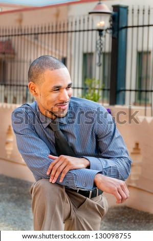 Young Handsome Professional African American in Casual, Relaxed Stance. Vertical. - stock photo