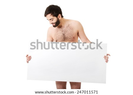 Young handsome shirtless man holding empty banner. - stock photo