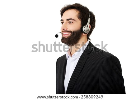 Young handsome smiling call center man. - stock photo