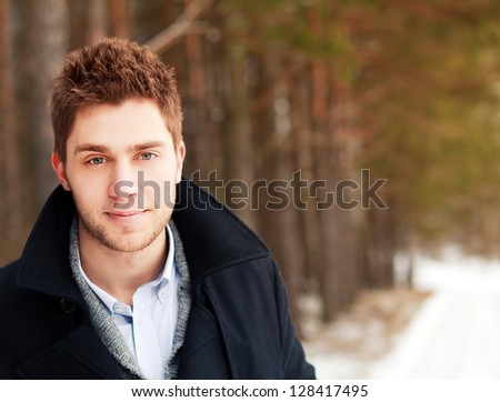 Young handsome smiling man outdoor portrait - stock photo