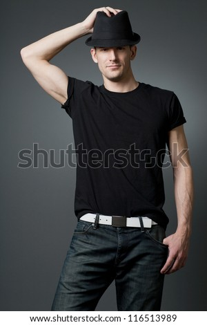 Young handsome tall guy posing in black t-shirt. - stock photo