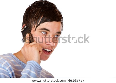 Young handsome teeanger makes a mobile phone call. Isolated on white. - stock photo