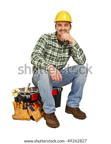 young handyman sit on his toolbox isolated on white - stock photo