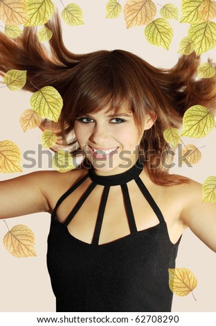 Young  happiness jumping woman/autumnal leaves