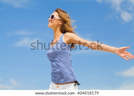 young happiness woman enjoying against blue sky - stock photo