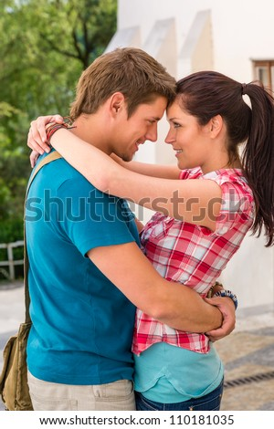 Young happy affectionate couple flirting outdoors smiling romance seduction love - stock photo