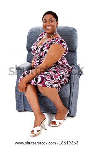 Young Happy African American Female Sitting on Sofa Comfortably