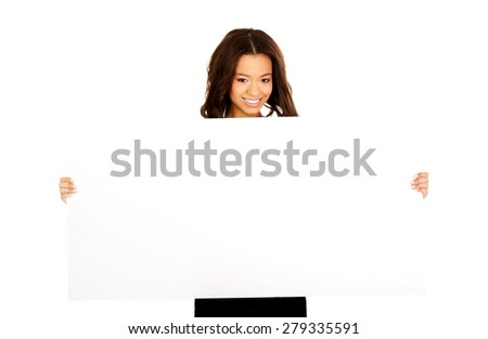 Young happy african teen with blank board. - stock photo