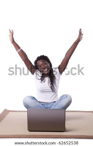 young happy african woman on the carpet surfing the internet (isolated on white) - stock photo