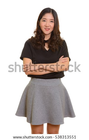 Young happy Asian businesswoman