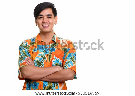 Young happy Asian man smiling with arms crossed isolated against white background