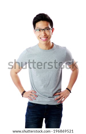 Young happy asian man standing over white background - stock photo