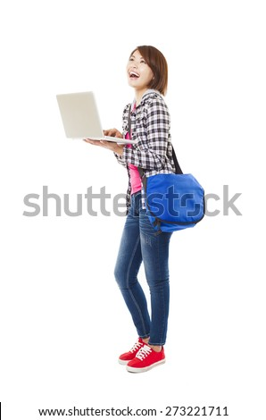 Young happy asian student with laptop and isolated on white - stock photo