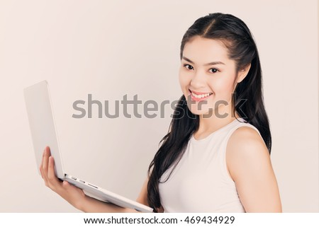 Young happy Asian woman with laptop, happy smiley face student with notebook pc.