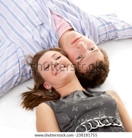 young happy beautiful couple lying on the floor - stock photo