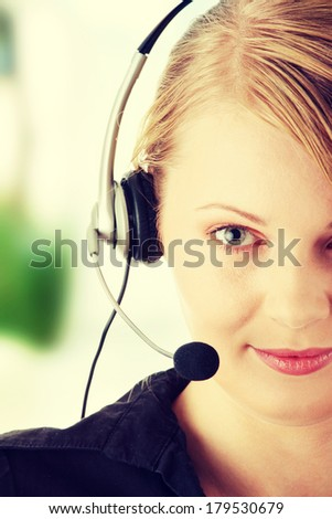 Young happy beautiful customer service operator girl in headset, smiling - stock photo